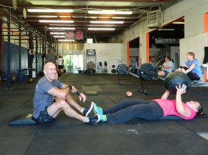 Sarah and me completing sit-ups as Lorraine rows.