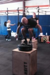 Executing box jump.